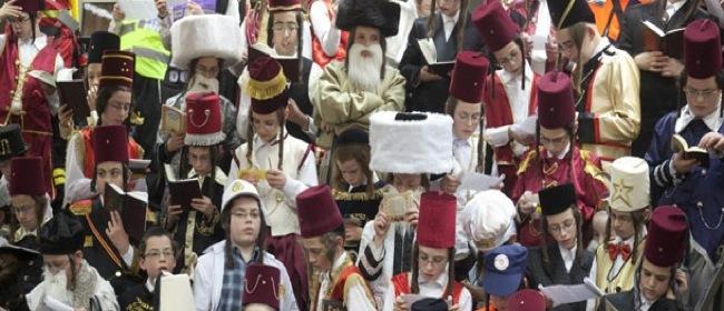 Israeli children in Purim costumes read