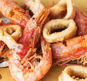 plate with fried seafood in sicilian restaurant
